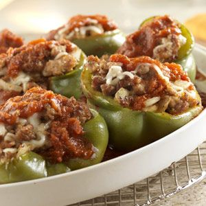 A savory combination of sweet Italian sausage, onion, oregano, and mozzarella cheese is tucked into tender green peppers and topped with tomato sauce for an easy-to-make version of this hearty classic.