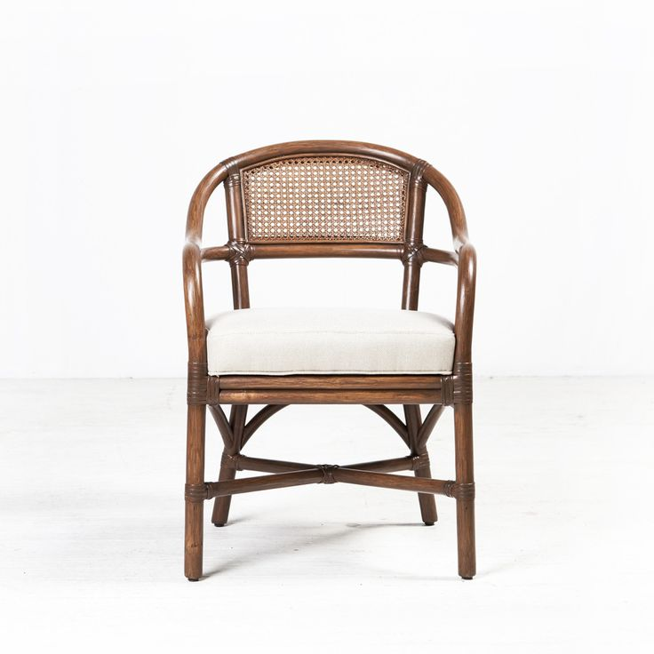 Vienna Dining Chair from Ambience Store. Featuring classic vienna weave caning, the Vienna Chair takes traditional materials and updates them with the lines of hand bent rattan. While it was designed for comfort - the proportion coupled with the round curve of the back and arms provide a welcoming shape - the rattan and double caning are known for durability.