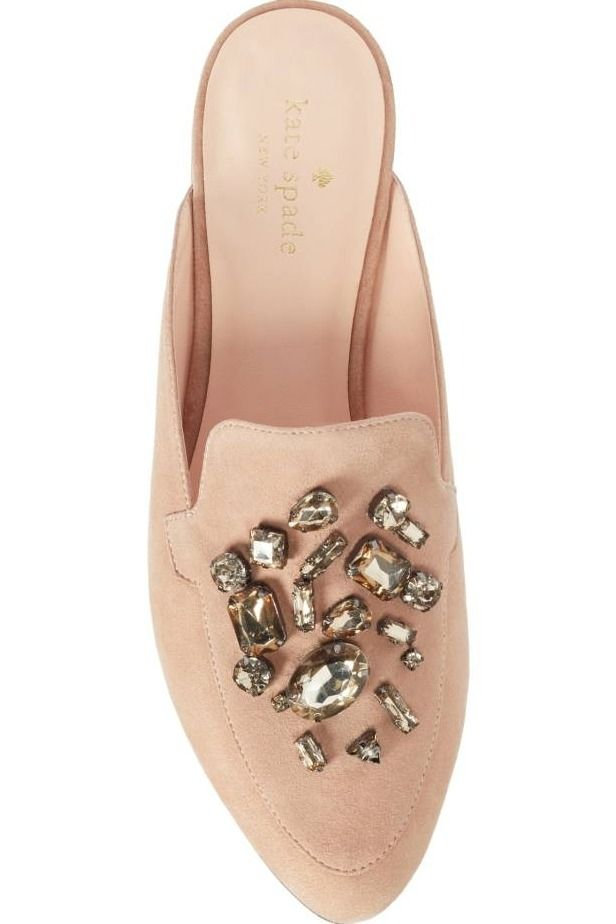 269f1002b099 A cluster of crystals sparkle and shine on this glamorous almond-toe mule  crafted from buttery-soft suede by Kate Spade.