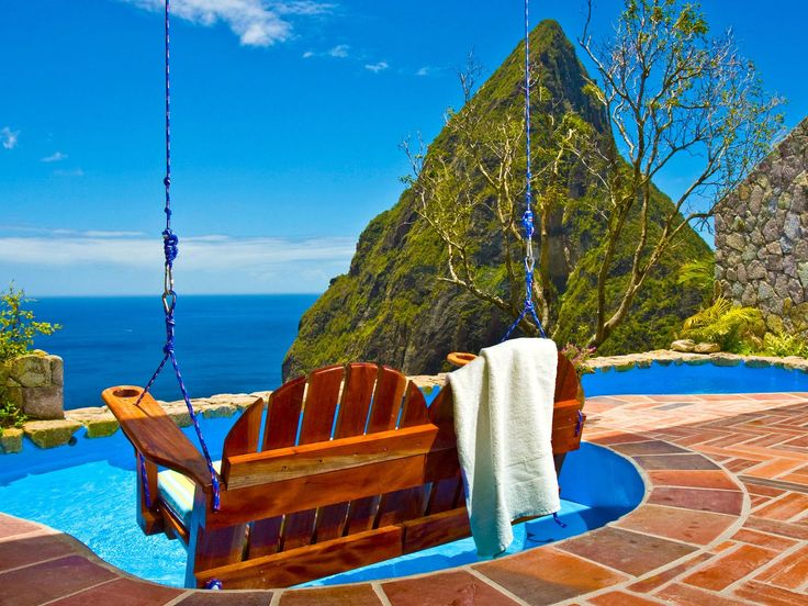"""Ladera, St. Lucia Each of the 32 suites here have only three walls, allowing for St. Lucia's famous Pitons to burst into view, while still affording guests complete privacy. No TVs, no phones... just the sound of tree frogs and birds here. Private plunge pools make it near-impossible to ever leave, and the property has on on-staff """"romance concierge"""" to schedule aphrodisiac cocktail-concocting classes and """"massage your mate"""" spa treatments. [Most romantic places]"""