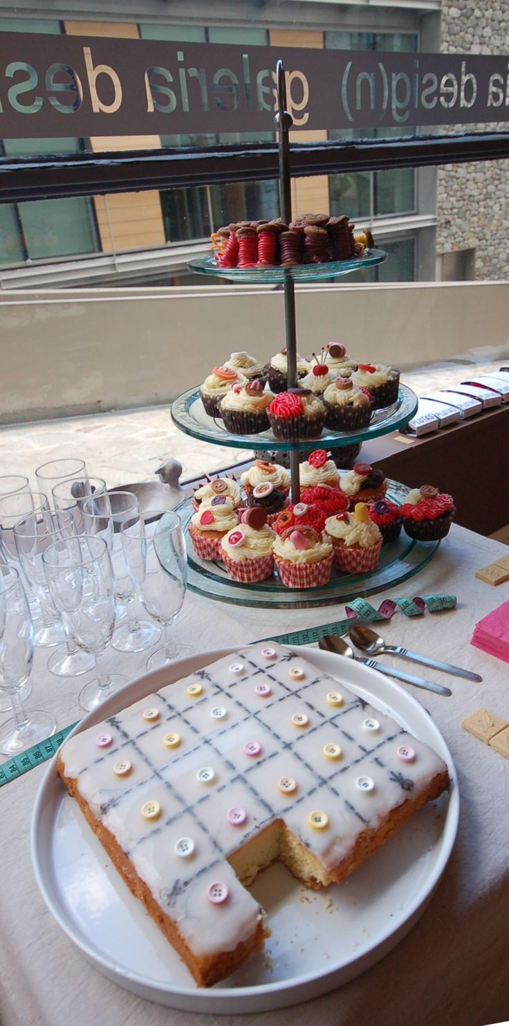 sewing themed party with cupcakes and lemon button cake at http://www.desig-design.com