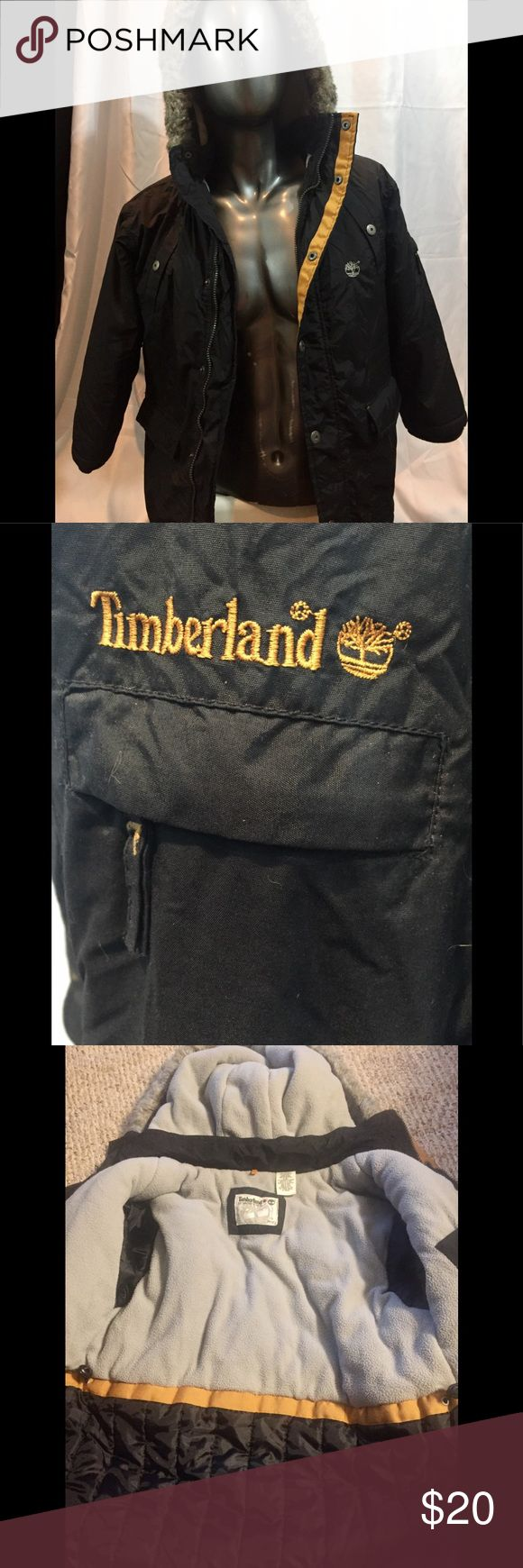 Extra warm winter coat by Timberland in size 8/10 Nice warm winter coat for boys size 8/10 by Timberland. Hoody is detachable. 2 zippered pockets up front and one with a push button. 1 zippered pocket on the sleeve. Knitted cuffs. Closes with zipper and push buttons. Inside covered with fleece. Has some wear . Timberland Jackets & Coats