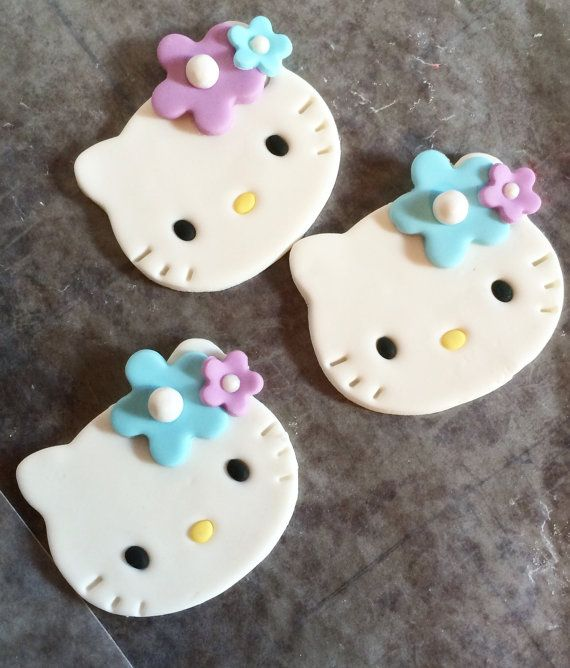 Hosting a Hello Kitty Party ? Let these be the center of your party! They are made of fondant so 100% edible. These decorations measure approx. 2.5-3 inches in length  If you would like to customize them please include your preference in the note to seller section upon placing your order. Contains: * 12 Hello Kitty fondant cupcake toppers with lavender and blue flowers. (If you would like different colored flowers please message me.) Please allow 1-2 weeks advance notice as they are…