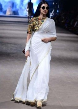 Model walks the ramp in white saree matched with sequin embellished blouse for Sabyasachis Big love collection at Lakme Fashion Week Summer Resort 2015