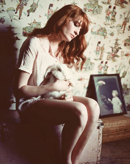 I just love Florence Welch... And she has a cute bunny on her lap? How perfect. her voice is a deliciously haunting and angelic. also...red hair...*sigh*