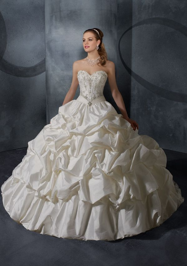 Silk taffeta with embroidery. This may be a little too big, but I love it. Looks like a big, fluffy cupcake!
