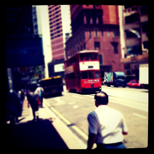 Crazy man, chasing tram. Only in HK