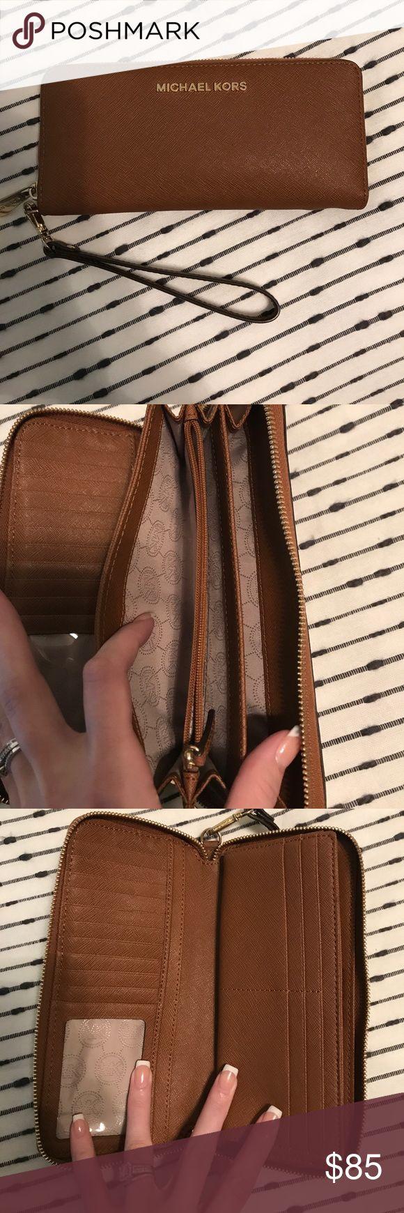 Authentic Michael Kors jet set wallet Like new brown jet set Michael Kors wallet. 100% authentic Michael Kors Bags Wallets