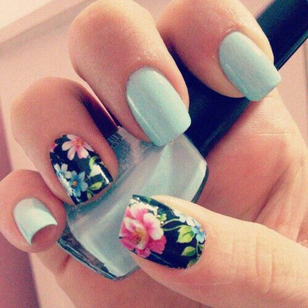 Amazing detail on the flowers amidst the clean and classic matte sky blue nails in contrast with the midnight blue background.