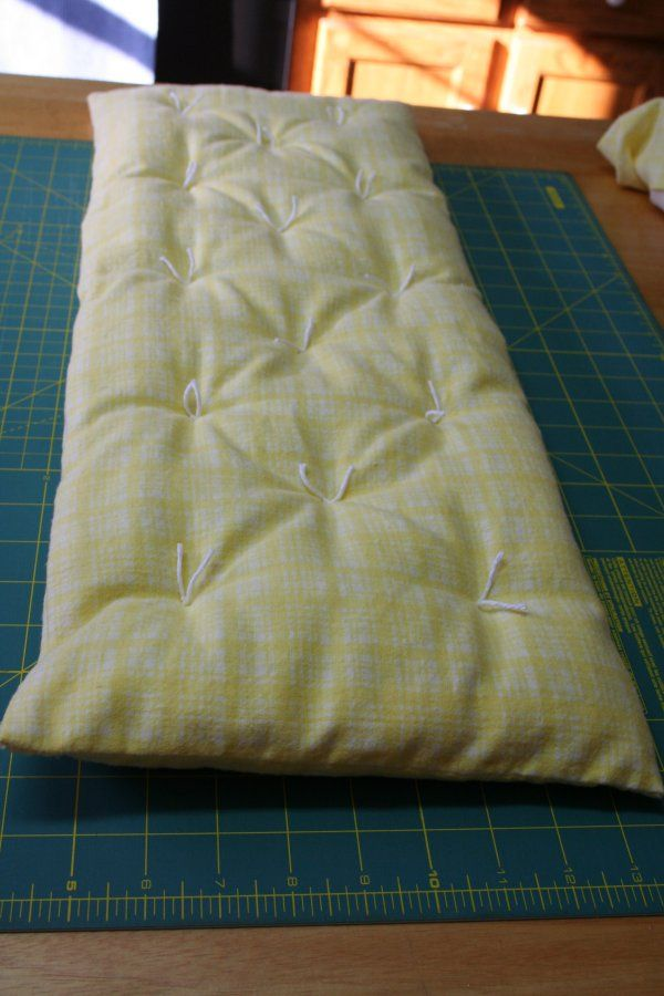 I thought I'd share how I went about making the bedding set for the doll cradle that I posted about last time . First, to make the mattress, I measured the inside bottom of the cradle.   It was 8 ½...