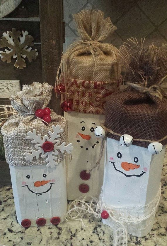 """Christmas Wood Snowman Family Set of 3 measures 8,10,&12"""" Tall  Hand painted faces w/ Burlap hats. Button/jingle bell accents. Made to order on Etsy, $27.00"""