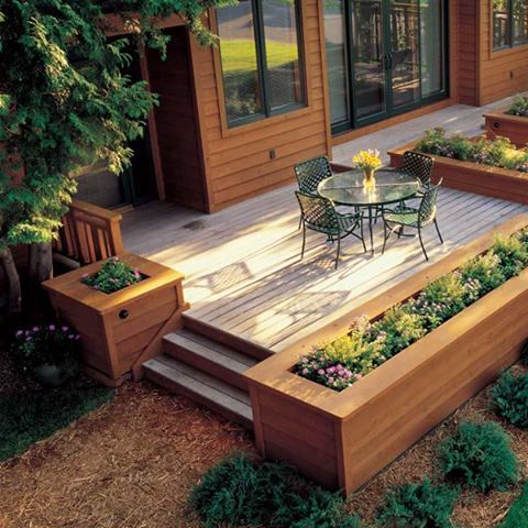 platform deck with large built-in planters from A+ Building Maintenance in Toledo, OH (I found the image on google, but the link took me to their FB page, and I couldn't find this photo.)