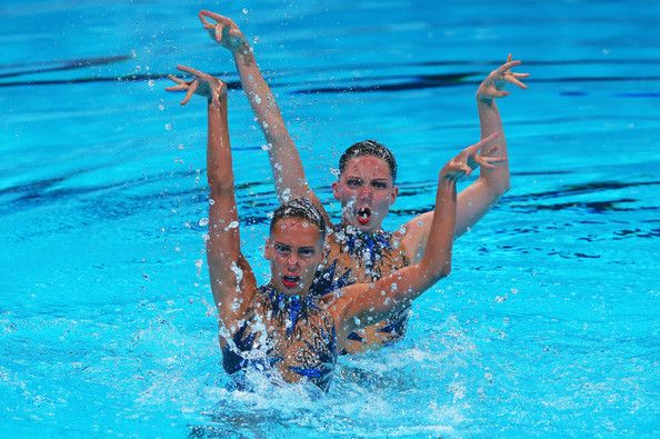 Jenna Randall and Olivia Federici of Great Britain compete in the Synchronized Swimming Duet preliminary round on day four of the 15th FINA World Championships at Palau Sant Jordi on July 23, 2013 in Barcelona, Spain.