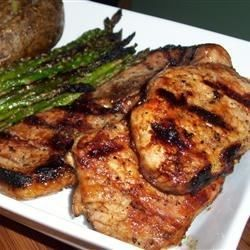 Pork chops are marinated in root beer and then glazed with a reduction of root beer, beef stock, Worcestershire sauce, and brown sugar while on the grill for a simple and tasty main dish.