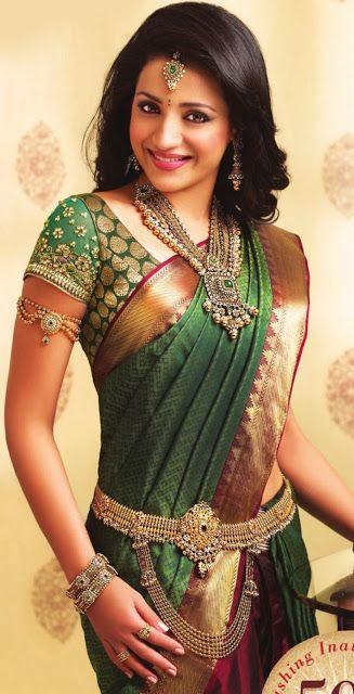 South Indian bride. Temple jewelry. Jhumkis.Green silk kanchipuram sari.Braid with fresh jasmine flowers. Tamil bride. Telugu bride. Kannada bride. Hindu bride. Malayalee bride.Kerala bride.South Indian wedding.Trisha Krishnan.