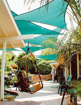 Sails can be quickly and easily attached to homes trees or patio columns to create shade and interest.