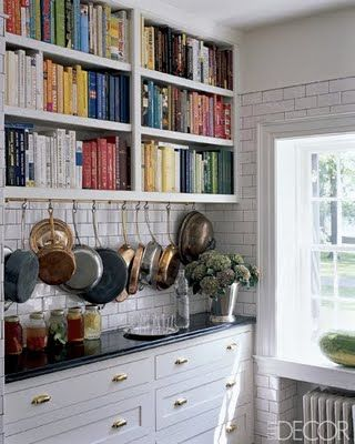 White, white, white! I love a bright white kitchen with subway tile, marble and wood counters, and brass hardware.