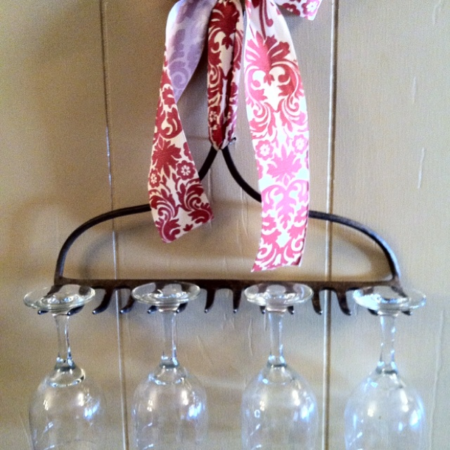 Rake wine rack held up with decorative ribbon