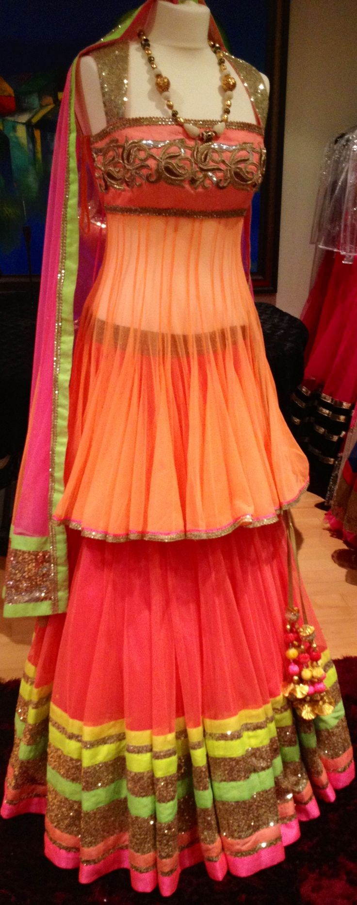 A perfect blend of the latest neon colors! It is indo-western wear for reception for the bride! If you are looking for a different dress for your recpetion, go for it without any doubt because it has different shades apart from common red, golden, etc and it has a different style, too! rock it!