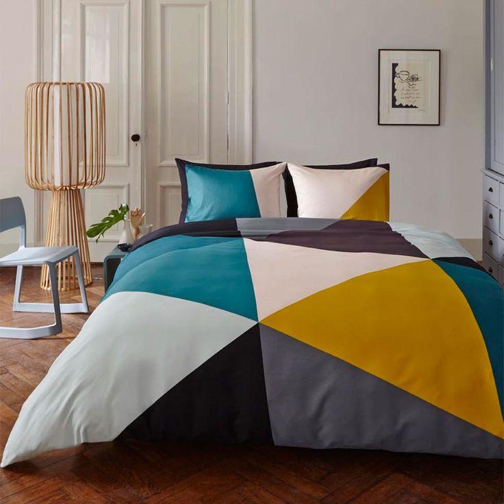slaapkamer met kleurrijk dekbed auping