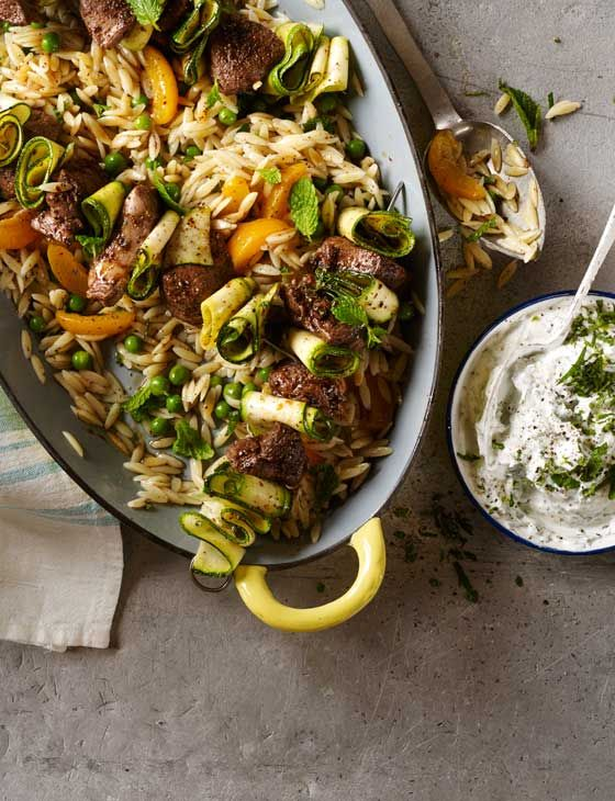 Lamb kebabs with pea, apricot and mint orzo and garlic yogurt. This spring dish is perfect for the Bank Holiday weekend.