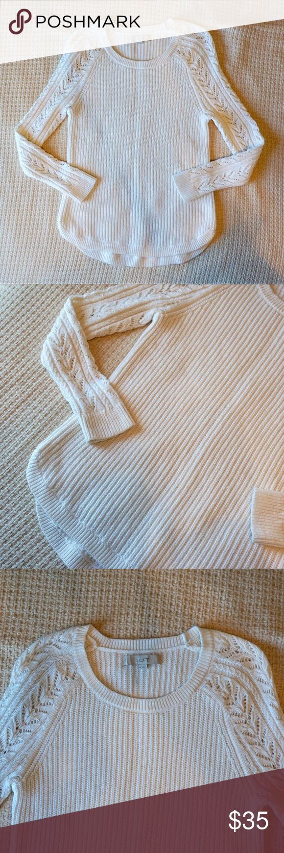LOFT cream knit sweater with curved hemline Classic cream sweater with knit pattern down sleeves. Perfect condition. LOFT Sweaters Crew & Scoop Necks