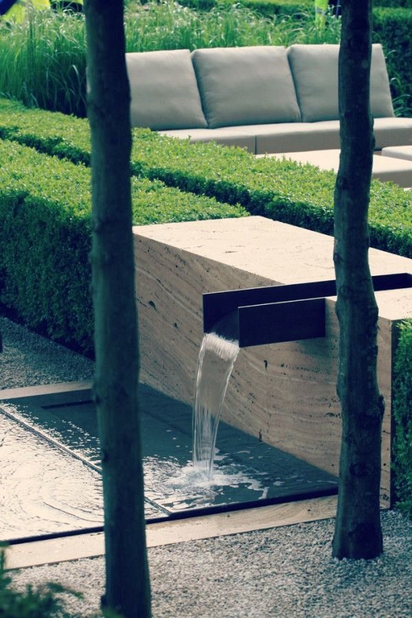 Love this water feature set into a concrete block