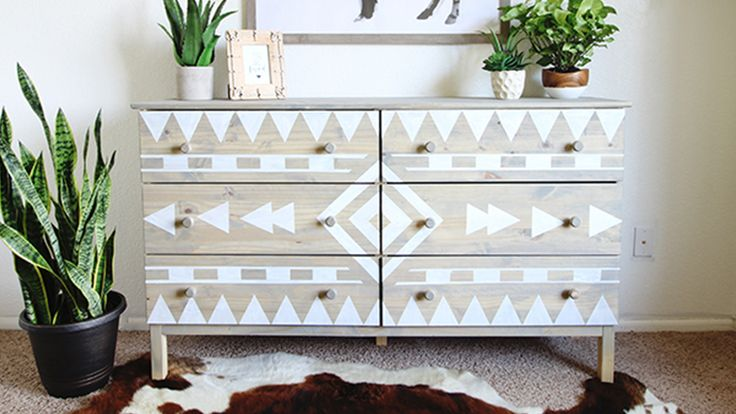 Using Scotch blue tape to create a native american design on this dresser