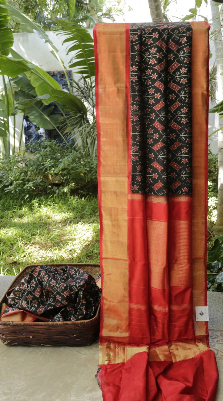 This jade black sari has a Ikat weave in ruby red and powder white. The border and pallu are in crimson red and gold zari making it a beautiful sari to own