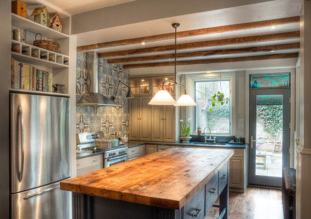 tile  exposed beams  butcher block island  eclectic kitchen by Kenny Grono