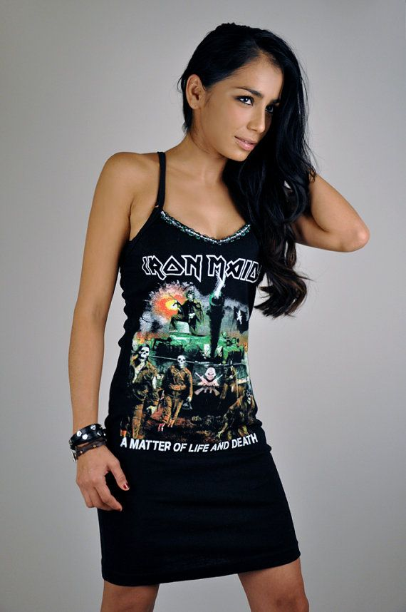 veraseyecandy on etsy.com, nice band ts moded into dresses and such, some are alittle $ but nice