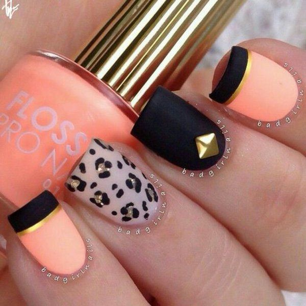 If you're working on a quirky and sassy design, this black orange and gold with a touch of animal print is the best design for you. And look how polished the matte nail polish looks.