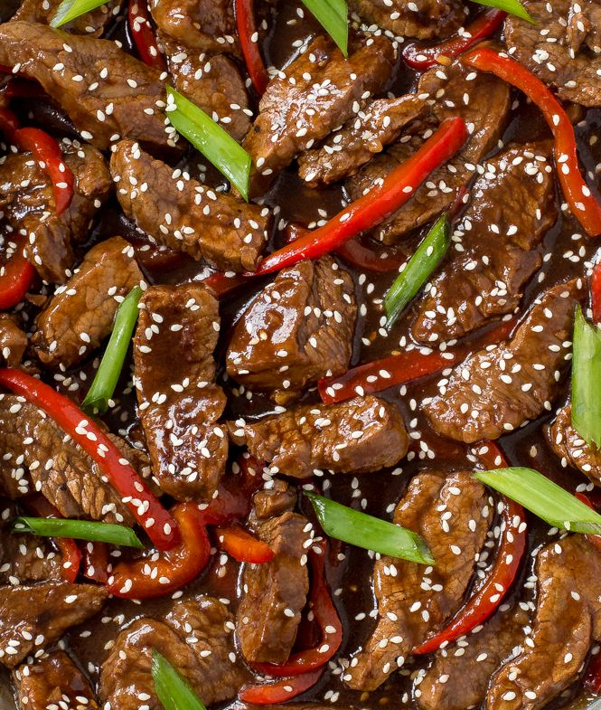 Super Easy Sesame Beef. Tender flank steak stir fried with red peppers and green onions. Better and healthier than takeout!