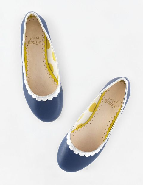 Dark blue leather ballet flats with silver scalloped edging.