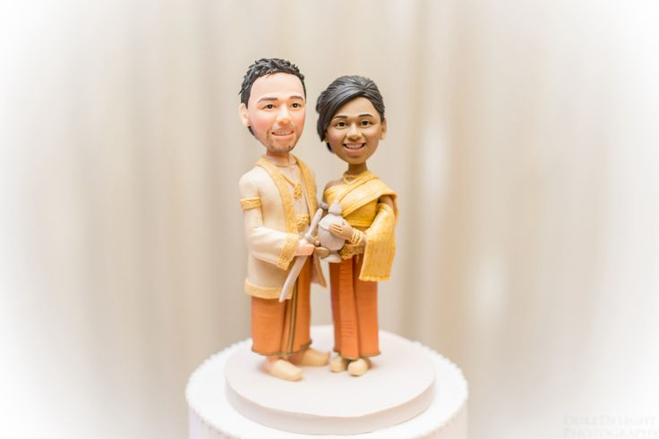 Customized Cambodian / khmer wedding cake toppers - perfect!   Go to                            http://mycaketoppers.com