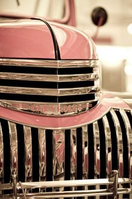 cool chrome and perfectly polished pink.  I will have an old truck with a paint job like this one day, if only as a flower planter.