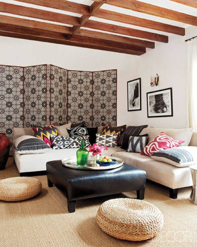In Ellen Pompeo's Hollywood home, bold patterned pillows and upholstered screens add personality to the den.