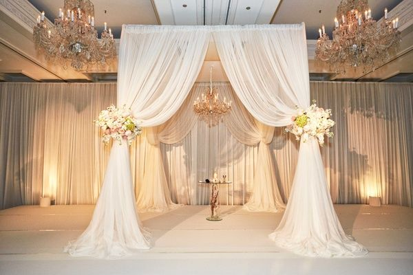 Elegant Chuppah with Ivory Drapery | Photography by KingenSmith. Read more: https://www.insideweddings.com/weddings/elegant-wedding-with-blush-ivory-and-gold-palette-in-chicago/769/.