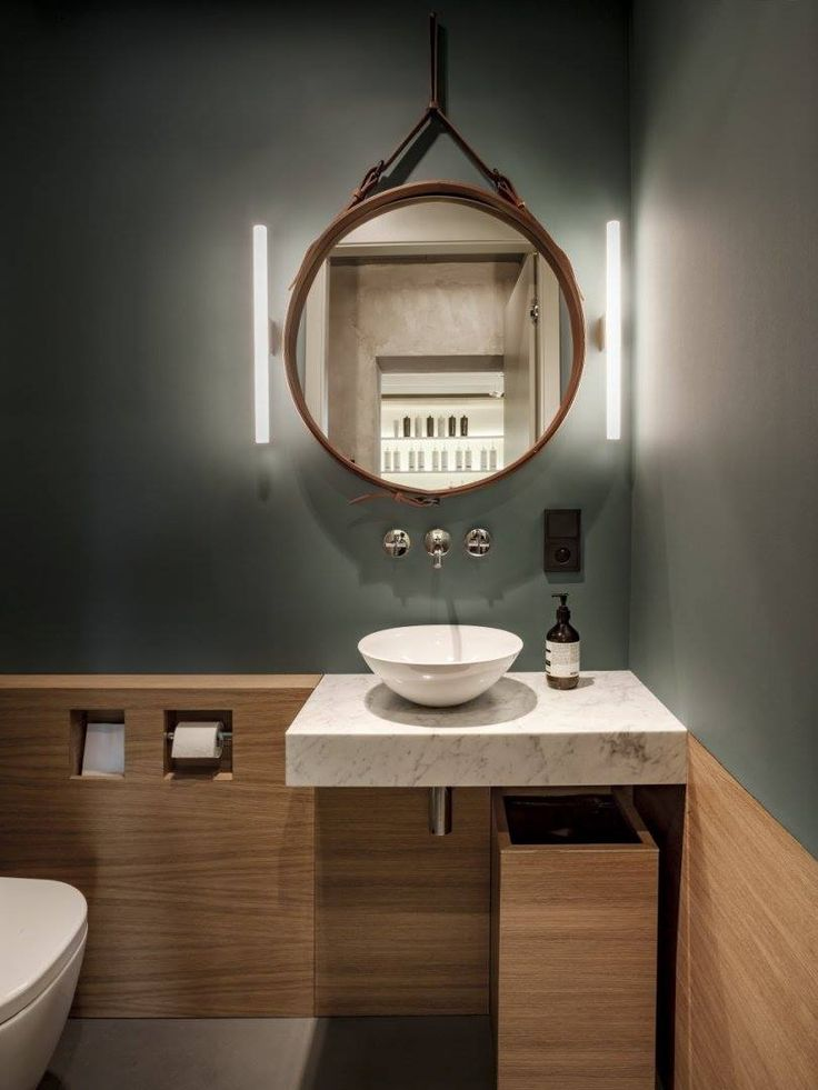Round iconic Adnet mirror by Gubi, available at MOOD showroom, Warsaw. Bathroom designed by Warsaw based studio Mood Works, Warsaw. #mood #moodworks #adnetmirror #roundmirror #gubimirror #gubi #beautifulbathroom