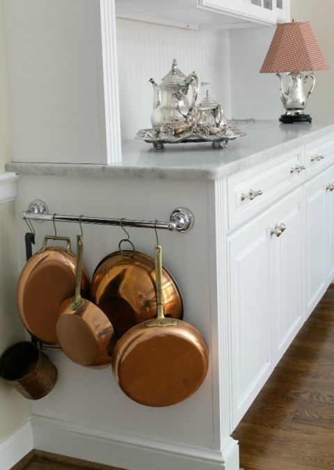 Mount a towel holder on the side of your cabinet and it instantly becomes a place to hand pots and pans.