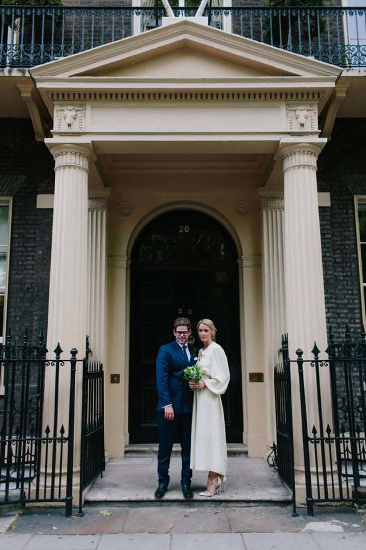 Bride Jess wears an original 1970's vintage Ossie Clarke dress for her Jewish wedding ceremony at Home House in London. Photography by Rebecca Goddard.