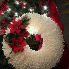 Coffee Filter Wreath! - Grab some cheap coffee filters from the Dollar Tree and a foam board or cardboard, which ever you have on hand. Some misc deco. I got mi…