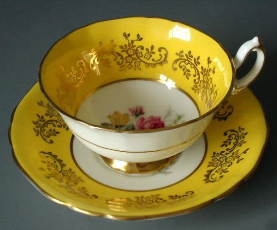 I think this is the exact design of teacup that my grandma had!  Love that I just found this.  Vintage Sunshine Yellow Tea Cup and Saucer Set