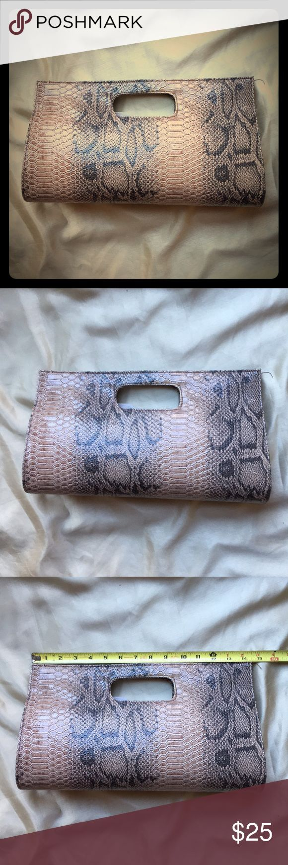 Snakes Embossed Clutch Beautiful snake embossed faux leather clutch. Classic styling with neutral pattern to go with everything. Very roomy interior. Interior pocket. Snap closure. A few pen spots in lining. See photos for measurements. Bags Clutches & Wristlets