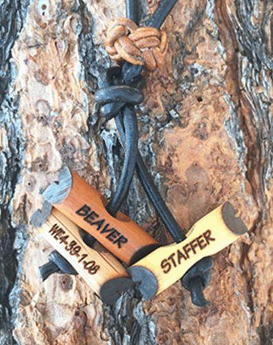 Three Wood Badge Engraved Beads