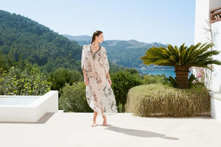 Ibiza style: What to wear to Es Cavallet | Sophisticated sheer maxi-kaftan from Aquamarine Ibiza, the perfect stylish option for a day at Es Cavallet.