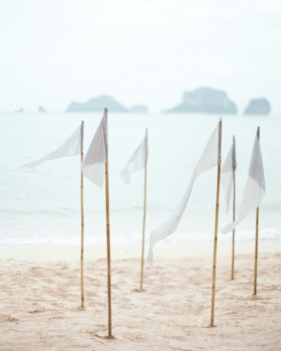 Hand-dyed silk flags marked the ceremony site on Phranang Beach.