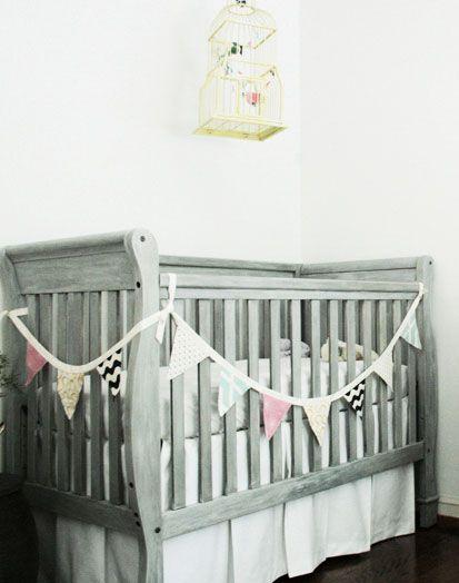 Google Image Result for http://www.babylifestyles.com/images/nursery/serene-modern-girl-nursery/modern-girl-baby-nursery-grey-crib-with-pennant-banner-and-birdcage-mobile.jpg