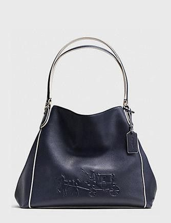 ... new arrivals coach embossed horse and carriage edie shoulder bag 7db5b  b492a 24e4fbd53dde1