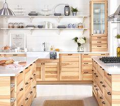 A large kitchen with SEKTION/TORHAMN natural ash doors.